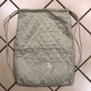 North Face cream colored quilted Backpack
